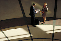 Man and woman discussing business. High view. Professionals. Lawyers. Businesswoman. Businessman. Denver Colorado USA.