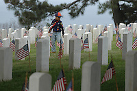 Saturday, May 22, 2009.  Fort Rosecrans National Cemetery, San Diego California, USA:  Brett Cox (7) of Northpark Troop 319 searches for the grave of his great-grandfather- a WWII veteran who is buried in Fort Rosecrans National Cemetery.  Hundreds of boy scouts, girl scouts and their parents fanned out across the cemetery to plant flags at each grave site to mark Memorial Day..