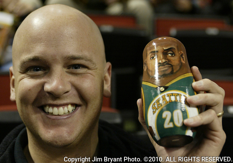 Seattle Supersonics fan Jemery Cook holds a Gary Peyton Nesting Doll he received for being one of first 5,000 fans attending the game between the Atlanta Hawks and Seattle Supersonics on Wednesday, Feb. 26, 2003 at Key Arena in Seattle. Cook watched the Supersonics beat the Hawks 93-76. Jim Bryant Photo. ©2010. All Rights Reserved.