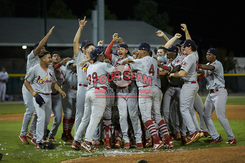 The Johnson City Cardinals celebrate after winning the 2019 Appalachian League Championship by defeating the Burlington Royals 8-6 at Burlington Athletic Stadium on September 4, 2019 in Burlington, North Carolina. (Brian Westerholt/Four Seam Images)