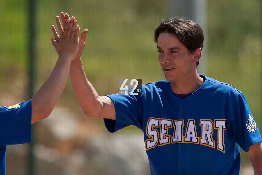 24 May 2009: Samuel Meurant of Senart is congratulated by his teammate during the 2009 challenge de France, a tournament with the best French baseball teams - all eight elite league clubs - to determine a spot in the European Cup next year, at Montpellier, France. Senart wins 8-5 over La Guerche.