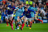 8th March 2020; Murrayfield Stadium, Edinburgh, Scotland; International Six Nations Rugby, Scotland versus France; George Horne of Scotland and Baptiste Serin of France chase a loose ball