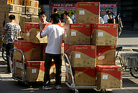 Chinese men convey Great Wall computers in Zhongguancun, Beijing, China. Great Wall, a manufacturer of computers and screens, is looking to increase its market share and speed up expansion into overseas markets, the company said in the statement..
