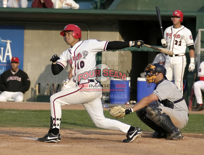 April 21, 2004:  Robinson Chirinos of the Lansing Lugnuts, Low-A Midwest League affiliate of the Chicago Cubs, during a game at Oldsmobile Park in Lansing, MI.  Photo by:  Mike Janes/Four Seam Images