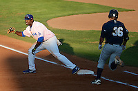 Justin Chigbogu (56) of the Ogden Raptors grabs the throw as Adam Giacalone (36) of the Helena Brewers runs to the bag in action against at Lindquist Field in Ogden Utah on July 20, 2013.  (Stephen Smith/Four Seam Images)