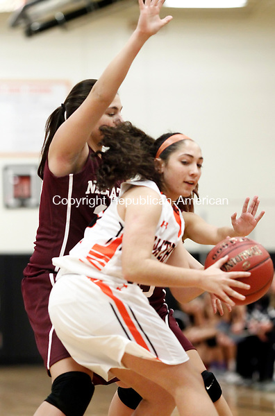 Watertown, CT- 10 December 2014-121014CM01-  Watertown's Julianna Rinaldi (13) looks to get around Naugatuck's Ally Mezzo during their season opener in Watertown on Wednesday.  Christopher Massa Republican-American