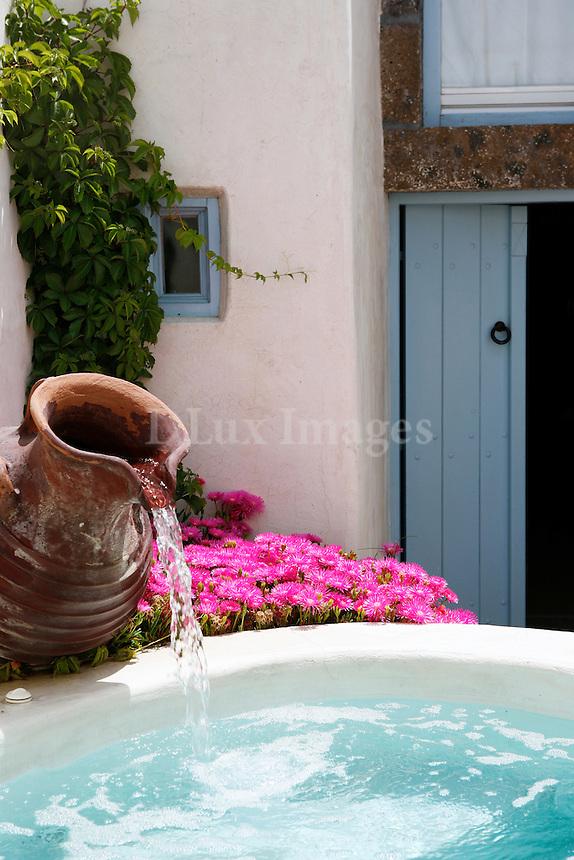 pottery jar on jacuzzi