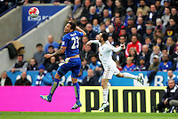 Leonardo Ulloa of Leicester City heads the ball during the Barclays Premier League match between Leicester City and Swansea City played at The King Power Stadium, Leicester on April 24th 2016