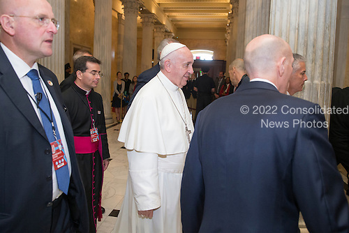 Pope Francis (C) arrives at the U.S. Capitol in Washington DC, USA, 24 September 2015. Pope Francis is on a five-day trip to the USA, which includes stops in Washington DC, New York and Philadelphia, after a three-day stay in Cuba. Pope Francis added the Cuba visit after helping broker a historic rapprochement between Washington and Havana that ended a diplomatic freeze of more than 50 years.<br /> Credit: Michael Reynolds / Pool via CNP