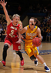 SIOUX FALLS, SD - MARCH 12:  Alexis Yackley #5 of the University of South Dakota pressures Gabby Boever #4 of South Dakota State during their championship game at the 2013 Summit League Tournament at the Sioux Falls Arena Tuesday. (Photo by Dick Carlson/Inertia)