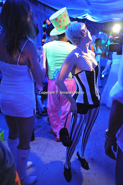 Revelers are seen at the Black and Light Ball on the Bowery in Lower Manhattan in New York, New York on May 9, 2009.