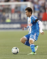 Philadelphia Union midfielder Michael Farfan (21) brings the ball forward. In a Major League Soccer (MLS) match, the New England Revolution (blue/red) defeated Philadelphia Union (blue/white), 2-0, at Gillette Stadium on April 27, 2013.