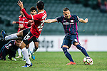 SC Kitchee Forward Nikola Komazec (r) attempts a kick during the 2017 Lunar New Year Cup match between SC Kitchee (HKG) vs Muangthong United (THA) on January 28, 2017 in Hong Kong, Hong Kong. Photo by Marcio Rodrigo Machado/Power Sport Images