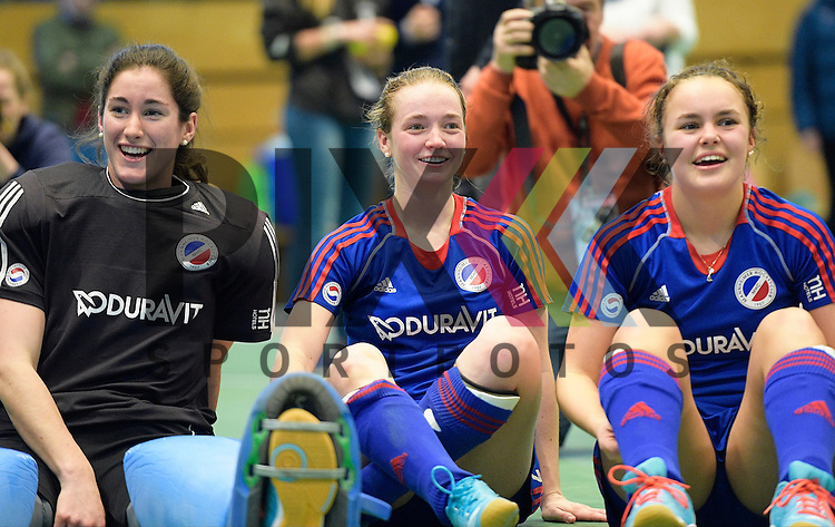 GER - Luebeck, Germany, February 07: Players of Mannheimer HC celebrate after winning the shootout during the 1. Bundesliga Damen indoor hockey final match at the Final 4 between Mannheimer HC (blue) and Duesseldorfer HC (white) on February 7, 2016 at Hansehalle Luebeck in Luebeck, Germany. Final score 6-4 after shootout. (L-R) Lisa Schneider #21 of Mannheimer HC, Sophia Willig #9 of Mannheimer HC, Kira Schanzenbecher #15 of Mannheimer HC<br /> <br /> Foto &copy; PIX-Sportfotos *** Foto ist honorarpflichtig! *** Auf Anfrage in hoeherer Qualitaet/Aufloesung. Belegexemplar erbeten. Veroeffentlichung ausschliesslich fuer journalistisch-publizistische Zwecke. For editorial use only.