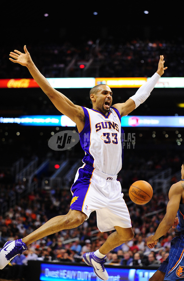 Jan. 26, 2011; Phoenix, AZ, USA; Phoenix Suns forward (33) Grant Hill reacts as he loses the ball while driving to the hoop in the second half against the Charlotte Bobcats at the US Airways Center. The Bobcats defeated the Suns 114-107. Mandatory Credit: Mark J. Rebilas-