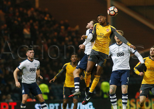 07.01.2017. Deepdale, Preston, England. FA Cup third round football. Preston versus Arsenal. Jeff Reine-Adelaide of Arsenal wins an aerial battle against Aiden McGeady of Preston.