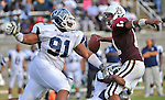 Alabama A&M quarterback Deaunte Mason (11) is sacked by Jackson State's Neal Pogue II (91) and Malcolm Palmer (below).  Alabama A&M university vs. Jackson State University at Louis Crews Stadium in Huntsville, AL Saturday Nov. 14, 2009.  Bob Gathany / The Huntsville Times