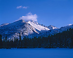 Snow-covered Bear Lake lies in the cool blue shadow of the surrounding mountains, Rocky Mountain National Park, CO