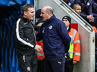 Bolton Wanderers' manager  Parkinson is greeted by Wigan Athletic's manager Paul Cook <br /> <br /> Photographer Andrew Kearns/CameraSport<br /> <br /> The EFL Sky Bet Championship - Wigan Athletic v Bolton Wanderers - Saturday 16th March 2019 - DW Stadium - Wigan<br /> <br /> World Copyright &copy; 2019 CameraSport. All rights reserved. 43 Linden Ave. Countesthorpe. Leicester. England. LE8 5PG - Tel: +44 (0) 116 277 4147 - admin@camerasport.com - www.camerasport.com