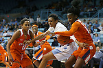 03 January 2016: Clemson's Aliyah Collier (right) takes the ball from North Carolina's Hillary Summers (center) as Clemson's Nelly Perry (0) watches. The University of North Carolina Tar Heels hosted the Clemson University Tigers at Carmichael Arena in Chapel Hill, North Carolina in a 2015-16 NCAA Division I Women's Basketball game. UNC won the game 72-56.