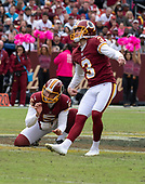 Washington Redskins kicker Dustin Hopkins (3) watches the flight of the ball after kicking what would be a 56 yard field goal early in the fourth quarter against the Carolina Panthers at FedEx Field in Landover, Maryland on October, 2018.  The Redskins won the game 23 - 17.  Washington Redskins punter Tress Way (5) was the holder.<br /> Credit: Ron Sachs / CNP