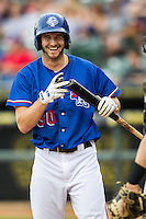 Round Rock Express outfielder Jared Hoying (30) laughs before stepping into the batters box during the Pacific Coast League baseball game against the Sacramento River Cats on June 19, 2014 at the Dell Diamond in Round Rock, Texas. The Express defeated the River Cats 7-1. (Andrew Woolley/Four Seam Images)