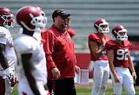 NWA Democrat-Gazette/ANDY SHUPE<br /> Arkansas coach Bret Bielema watches Saturday, Aug. 5, 2017, prior to the start of a scrimmage in Razorback Stadium in Fayetteville. Visit nwadg.com/photos to see more photographs from the practice.