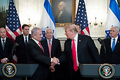 Prime Minister of Israel Benjamin Netanyahu (Front L) and US President Donald J. Trump (Front R) shake hands before Trump signed an order recognizing Golan Heights as Israeli territory, in the Diplomatic Reception Room of the White House in Washington, DC, USA, 25 March 2019.<br /> Credit: Michael Reynolds / Pool via CNP