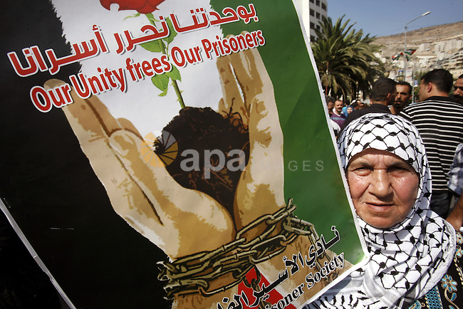 A Palestinian woman takes part in a protest in the West Bank city of Nablus on October 3, 2011, to show their solidarity with Palestinian prisoners held in Israeli jails. On Wednesday, Palestinian prisoners in Israel went on a hunger strike in a call to ease their plight. Photo by Wagdi Eshtayah