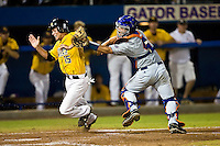 June 07, 2009:  NCAA Super Regional: Southern Miss Golden Eagles vs Florida Gators:   Southern Miss(15) Corey Stevens is tagged out by Florida catcher (4) Buddy Monore during game two of Super Regional action at Alfred A. McKethan Stadium on the campus of University of Florida in Gainesville.  Southern Miss came from behind to defeat Florida 7-6 and to advance to the College World Series.   ...........