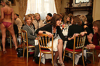Ladies chat during a underwear show at a tea party in Kensington, London