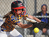 East Meadow LF No. 18 Rachel Travis advances runners to second and third with a bunt in the top of the top of the second inning of of a Nassau County varsity softball game against host Long Beach High School on Monday, May 4, 2015. Long Beach won by a score of 2-0.<br /> <br /> James Escher