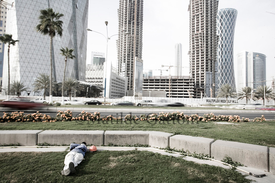 Qatar - Doha - Worker resting  in Financial District