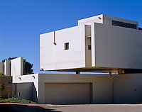 The whole upper section of this house appears to float supported solely by the pillars beneath it