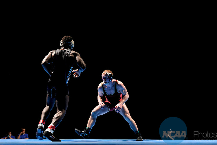12 MAR 2011: Josh Terrell of Dubuque takes on Nick LeClere of Coe in the 165 lbs championship match during the Division III Men's Wrestling Championship held at the La Crosse Center in La Crosse Wisconsin. Terrell defeated LeClere 6-5 to claim the national title. Stephen Nowland/NCAA Photos