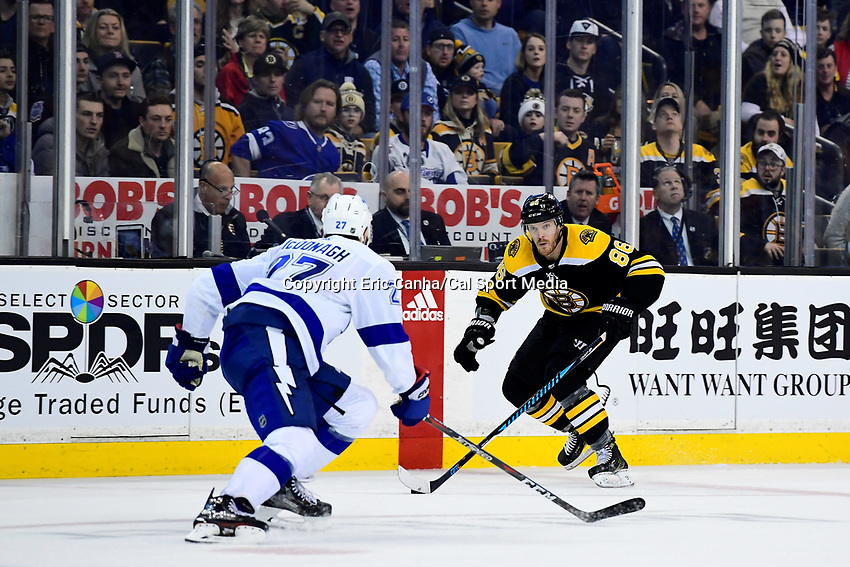 March 29, 2018: Boston Bruins defenseman Kevan Miller (86) gets pressure from Tampa Bay Lightning defenseman Ryan McDonagh (27) as he works through the neutral zone during the NHL game between the Tampa Bay Lightning and the Boston Bruins held at TD Garden, in Boston, Mass. Boston defeats Tampa Bay 4-2. Eric Canha/CSM