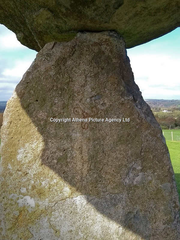 """Pictured: The vandalised ancient monument of Pentre Ifan in Pembrokeshire, Wales, UK<br /> Re: Police, National Park Authority and Cadw officers are investigating damage to a 5,500-year-old monument in Pembrokeshire.<br /> Graffiti has been painted on the Pentre Ifan burial chamber near Nevern, and police are appealing for information to find those responsible.<br /> PC Esther Davies, of the Dyfed-Powys Police rural crime team, said: """"We are saddened by the vandalism to the Pentre Ifan burial chamber. This is one of the most famous prehistoric sites in Wales, and it is unacceptable that someone has done this.<br /> """"Not only have they damaged the monument, but they have caused significant damage to the lichens growing on the stones.<br /> """"Cadw are working closely with us, and will be dealing with the removal of the paint.<br /> """"We would urge anyone who has information about the culprit to contact the Rural Crime team by calling 101.""""<br /> Proactive patrols are being carried out by officers, in partnership with Cadw and the Pembrokeshire Coast National Park Authority, at other sites of historic importance to ensure no further damage is caused elsewhere.<br /> Inspector Roger Smith, Heritage Crime Liaison Officer, said: """"We take heritage crime such as this very seriously within Dyfed-Powys.<br /> """"Pentre Ifan is a scheduled ancient monument of immense national and international significance, and we are investigating the damage to it as a priority.<br /> """"We are working closely with our colleagues from both Cadw and the National Park Authority. We are currently piloting a proactive Heritage Watch programme within the National Park, where police officers and PCSOs, together with Cadw wardens and National Park Rangers, are patrolling heritage sites in order to prevent damage and antisocial behaviour."""""""