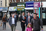 © Joel Goodman - 07973 332324 . 11/04/2015 . Bury , UK . Labour Shadow Chancellor Ed Balls and James Frith , Labour candidate for Bury North , at a campaign stop at The Rock shopping centre , Bury in Greater Manchester , UK . The pair met parents and discussed family finances . Photo credit : Joel Goodman
