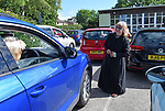 Pictured:  Reverend Claire Towns, of St Barnabas Church, led the unique drive-in service, which began at 10am in Swanmore, Hants.<br /> <br /> A church today hosted its first ever drive-in service, with a vicar leading the event from a car park.  Around 40 cars full of worshipers gathered outside a village hall to hear music and listen to the words of the minister.<br /> <br /> Everyone in the vehicles put their driver side window down, so they could join in with the singing, but left the passenger window up to help with social distancing.  People put their hands through the sunroof of their cars and clapped along while reading from hymn sheets provided by the church.  SEE OUR COPY FOR DETAILS.<br /> <br /> © Simon Czapp/Solent News & Photo Agency<br /> UK +44 (0) 2380 458800