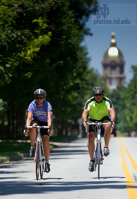 University of Notre Dame College of Science dean Greg Crawford, right, and his wife Renate ride their bikes along Notre Dame Avenue.  The Crawfords will bike from Tucson, AZ to Notre Dame in July and August of 2010 to raise awareness of Notre Dame's new partnership with the Ara Parseghian Medical Research Foundation...Photo by Matt Cashore/University of Notre Dame