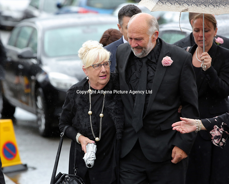 """COPY BY TOM BEDFORD<br /> Pictured: Mourners attending the service at the Jerusalem Baptist Chapel, Merthyr Tydfil, Wales, UK. Friday 18 August 2017<br /> Re: The funeral of a toddler who died after a parked Range Rover's brakes failed and it hit a garden wall which fell on top of her will be held today at Jerusalem Baptist Chapel in Merthyr Tydfil.<br /> One year old Pearl Melody Black and her eight-month-old brother were taken to hospital after the incident in south Wales.<br /> Pearl's family, father Paul who is The Voice contestant and mum Gemma have said she was """"as bright as the stars""""."""