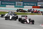 1st October 2017, Sepang, Malaysia;  FIA Formula One World Championship, Grand Prix of Malaysia, 31 Esteban Ocon (FRA, Sahara Force India F1 Team), 18 Lance Stroll (CAN, Williams Martini Racing), 19 Felipe Massa (BRA, Williams Martini Racing)