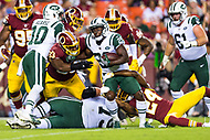 Landover, MD - August 16, 2018: New York Jets running back Bilal Powell (29) is hit in the back field by Washington Redskins defensive end Jonathan Allen (93) and Washington Redskins defensive back Josh Norman (24) during preseason game between the New York Jets and Washington Redskins at FedEx Field in Landover, MD. (Photo by Phillip Peters/Media Images International)