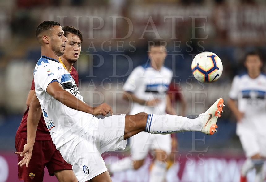 Calcio, Serie A: Roma - Atalanta, Stadio Olimpico, 27 agosto, 2018.<br /> Atalanta's Ali Adnan (front) in action Roma's Cengiz Under (back) during the Italian Serie A football match between Roma and Atalanta at Roma's Stadio Olimpico, August 27, 2018.<br /> UPDATE IMAGES PRESS/Isabella Bonotto