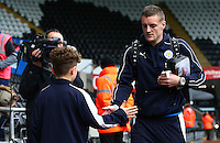 Jamie Vardy of Leicester City shakes hands with a mascot as he arrives before the Barclays Premier League match between Swansea City and Leicester City played at The Liberty Stadium on 5th December 2015