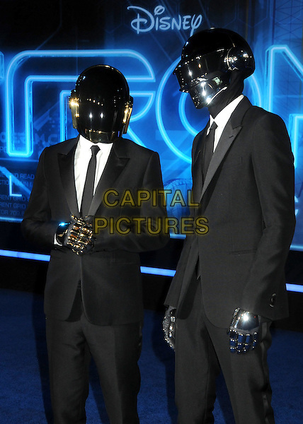 "DAFT PUNK .""TRON: Legacy"" L.A. Premiere held at the El Capitan Theatre, Hollywood, California, USA, 11th December 2010..half length helmets band group djs suit tie white shirt gloves .CAP/ADM/BP.©Byron Purvis/AdMedia/Capital Pictures."