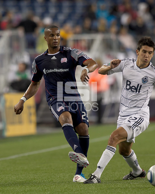 New England Revolution midfielder Darrius Barnes (25) passes the ball as Vancouver Whitecaps FC midfielder Shea Salinas (22) defends. In a Major League Soccer (MLS) match, the New England Revolution defeated the Vancouver Whitecaps FC, 1-0, at Gillette Stadium on May14, 2011.
