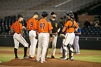 AZL Giants manager Hector Borg (13) visits with infielders Kyle McPherson (7), Nico Giarratano (9), Nathanael Javier (47), and catcher Jeffry Parra (5) during a pitching change against the AZL Rangers on August 22 at Scottsdale Stadium in Scottsdale, Arizona. AZL Rangers defeated the AZL Giants 7-5. (Zachary Lucy/Four Seam Images via AP Images)