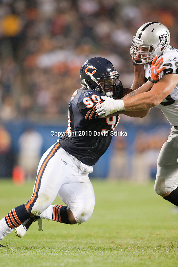 Chicago Bears defensive lineman Julius Peppers (90) plays defense during an NFL preseason football game against the Oakland Raiders in Chicago, Illinois on August 21, 2010. The Raiders won 32-17. (AP Photo/David Stluka)