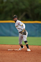 GCL Pirates shortstop Norkis Marcos (3) throws to first base during a Gulf Coast League game against the GCL Rays on August 7, 2019 at Charlotte Sports Park in Port Charlotte, Florida.  GCL Rays defeated the GCL Pirates 4-1 in the first game of a doubleheader.  (Mike Janes/Four Seam Images)